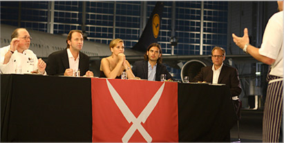 Judgment in the Next Iron Chef competition in Munich. From left, Bernd Schmitt, myself, restaurateur Donatella Arpaia, editor Andrew Knowlton, and host, Alton Brown interrogate San Francisco chef Chris Cosentino. Photo courtesy of The Food Network