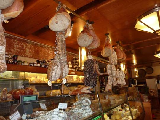 Salumeria in Bologna: culatello, hams, pancetta and salami hanging