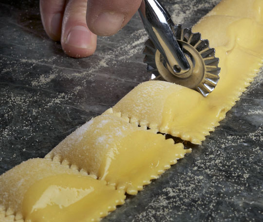 Trimming the agnolotti.