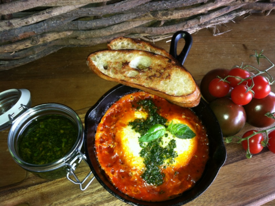 Baked eggs – ready to be topped with salsa verde