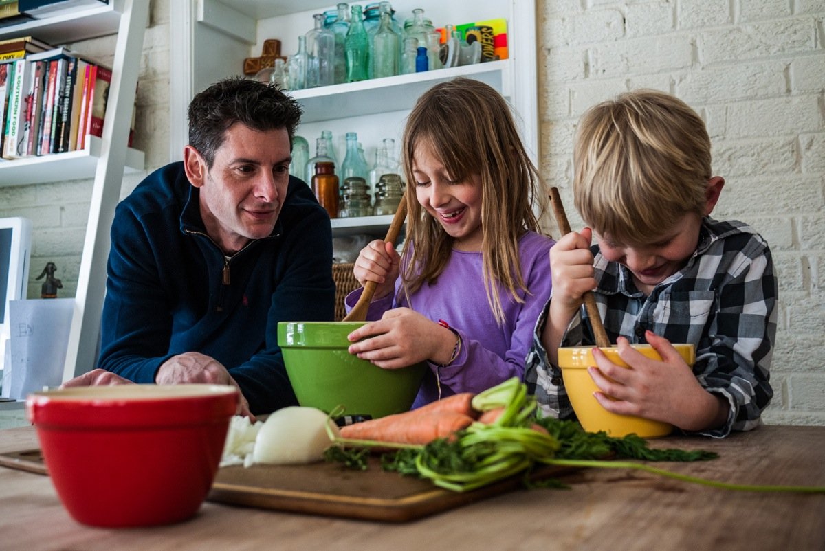 Christopher Freeman, and his kids Tatum and Cash, cooking together/photo by Justin Park-Yanovitch