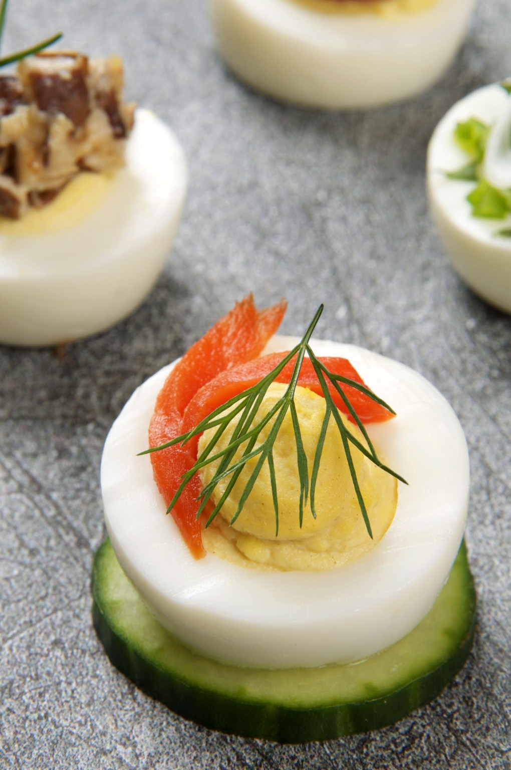 Deviled egg with smoked salmon and dill on a cucumber wheel. Photo by Donna Turner Ruhlman.